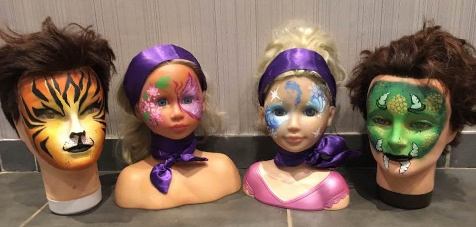 Voorbeelden van geschminkte kindersnoetjes-poppen